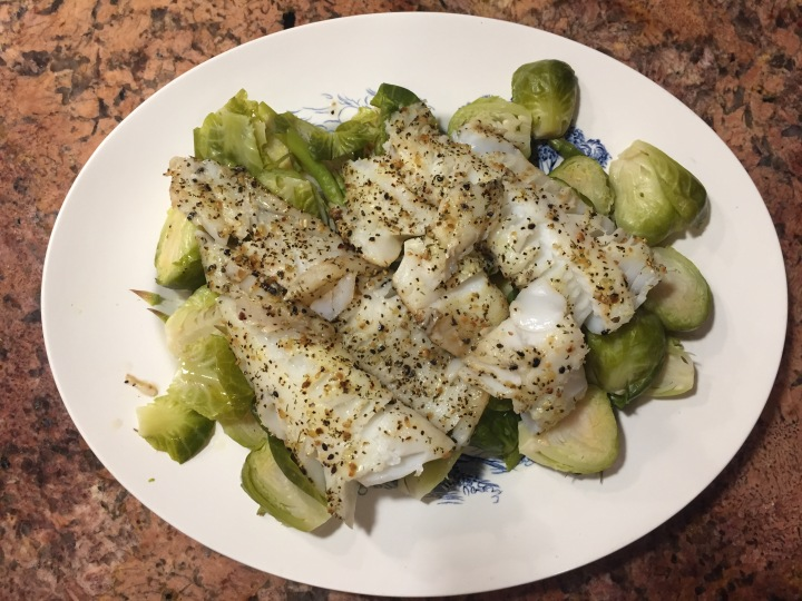 cooked white fish on veggies